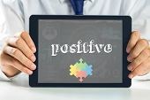 picture of autism  - The word positive and autism awareness jigsaw against medical biology interface in blue - JPG