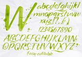 stock photo of alphabet  - Modern alphabet set drawn watercolor blots and stains with a spray green color - JPG
