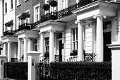 pic of architecture  - Black and white monochrome photograph picture of  expensive old fashioned typical Regency Georgian terraced town houses building architecture in fashionable Notting Hill - JPG