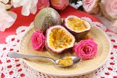 picture of passion fruit  - Passion fruit on plate on color napkin background - JPG