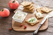 pic of crisps  - Crisps With Cream Cheese On The Wooden Board - JPG
