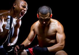 pic of pep talk  - Trainer motivating a muscular Boxer or MMA fighter with pep talks - JPG