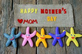 foto of i love you mom  - Happy mothers day with i love you mom message idea from colorful fabric starfish on wooden background beautiful flower abstract wooden texture mother - JPG