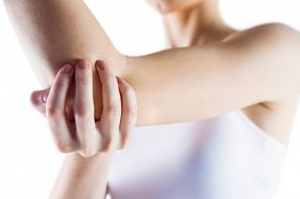 picture of elbow  - Fit woman with elbow injury on white background - JPG
