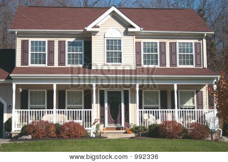 Picture or photo of new colonial or country style two for Front porch designs for two story houses