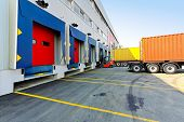 stock photo of loading dock  - Forklift and trucks at cargo dock of warehouse - JPG