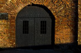 stock photo of dungeon  - Dungeon like doors of the Roman well at Kalemegdan fortress - JPG
