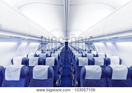 Modern Airplane seats in perspective. Transportation concept. Aircraft\'s corridor interior in modern