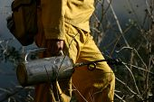 pic of retarded  - a firefighter walks dangerously close to the advancing flame armed with flame retardants - JPG
