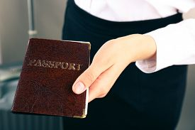 image of passport cover  - Woman holding passport close up - JPG