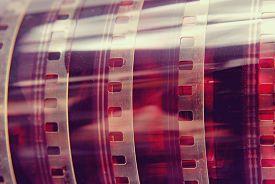 stock photo of analogy  - Closeup detail of vintage analog photography film strip background - JPG