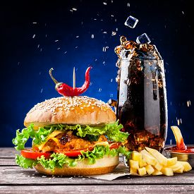 picture of veggie burger  - Veggie burger French fries ketchup and ice cubes falling in cola glass - JPG