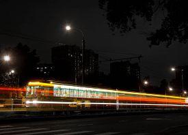 stock photo of tram  - tram and crosswalk at night long exposure - JPG