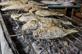 stock photo of crust  - Closeup Thai Food Salt Crusted Grilled Fish - JPG