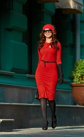 picture of beret  - Beautiful brunette young woman wearing red dress - JPG