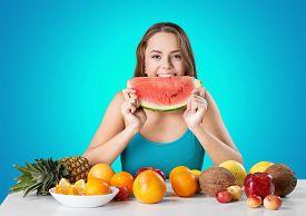 stock photo of finger-licking  - Eating Watermelon Licking Human Finger Blueberry Teenage Girls Fruit Healthy Eating - JPG