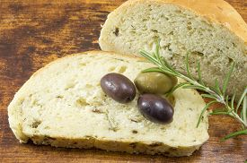 picture of fresh slice bread  - Olive bread slice with fresh olives and parsley - JPG