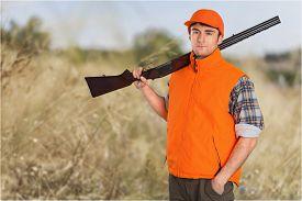 stock photo of shotgun  - Hunting Hunter Men Game Shooting Hat Field Shotgun - JPG
