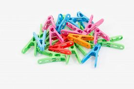 picture of pegging  - Plastic clothes pegs isolated on white background - JPG