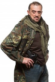 pic of terrorist  - Male terrorist in a military jacket with a gun in his hand - JPG