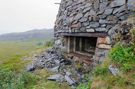 stock photo of murmansk  - Remains of a German bunker from the Second World War on the Rybachy peninsula near Murmansk - JPG