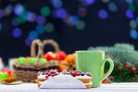 pic of eclairs  - Eclair and cup of coffee or tea on wooden table - JPG