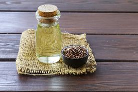 stock photo of flax seed oil  - flax seed oil in glass bottles on a wooden table