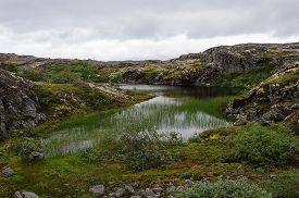 image of murmansk  - Small picturesque lake in rocky tundra on the Rybachy peninsula near Murmansk Russia  - JPG