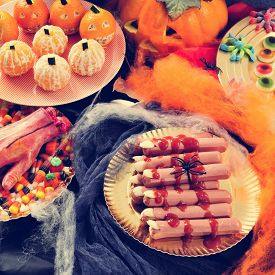 stock photo of amputation  - some plates with different Halloween food - JPG