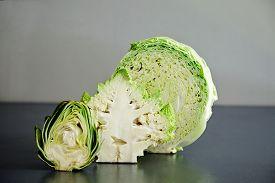 foto of romanesco  - Half splitted artichocke with cabbage and romanesco broccoli - JPG