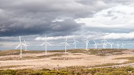 picture of dynamo  - wind turbines isolated on dark background overcast - JPG