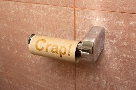 stock photo of adversity humor  - Concept of running out of toilet paper - JPG