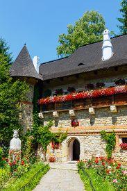 stock photo of suceava  - The Moldovita Monastery is a Romanian Orthodox monastery situated in the commune of Vatra Moldovitei Suceava County Moldavia Romania - JPG