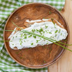 foto of fresh slice bread  - Slice of rye bread with cream cheese with fresh cloves - JPG
