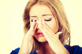 pic of sinuses  - Beautiful young woman with sinus pressure pain - JPG
