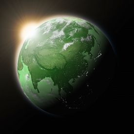 picture of southeast  - Sun over Southeast Asia on green planet Earth isolated on black background - JPG