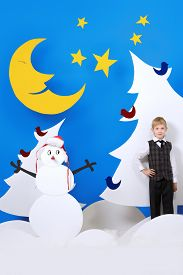 foto of boys night out  - Cheerful boy in a cartoon fairy snowy forest - JPG