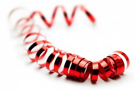 picture of coil  - Red ribbon coil or spiraling on white surface - JPG
