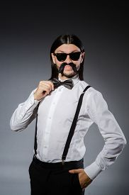 pic of moustache  - Man with moustache and sunglasses against gray - JPG