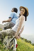 couple on a classic bicycle in the countryside