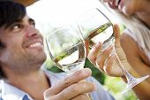 couple enjoying a glass of whitewine in the garden