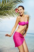 stock photo of hula dancer  - young female dancing on the beach - JPG