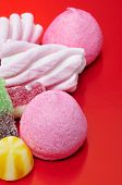 a pile of candies on a red background