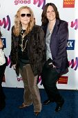 LOS ANGELES - APR 10: Melissa Etheridge (L) and guest arrive at the 22nd annual GLAAD Media Awards a