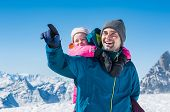Young father enjoying with daughter a sunny winter day. Happy father with daughter enjoying winter v poster