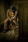 picture of flogging  - Cowboy with Black Leather Flogging Whip in his hand against wooden background - JPG