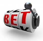 The letters in the word Bet line up for a jackpot on 3 slot machine wheels, symbolizing a jackpot of