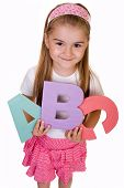 schoolgirl holding alphabet letters, school concept
