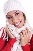 happy woman wearing woolen scarf and hat in winter