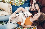 Happy Hipster Couple With Bulldog Relaxing In Hammock On The Beach In Sunset Light, Summer Vacation. poster